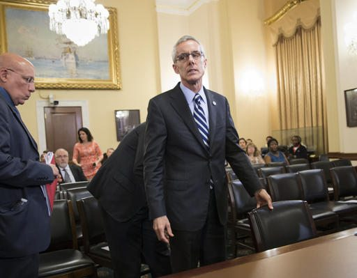 Transportation Security Administration chief Peter Neffenger arrives on Capitol Hill in Washington on Wednesday to testify before the House Homeland Security Committee which is looking for answers on how to balance security with long lines at airport checkpoints. (AP Photo/J. Scott Applewhite)