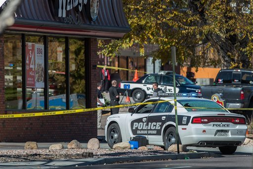 The rear window of a Colorado Springs Police car is shattered after a shooting Saturday in Colorado Springs, Colo. (Christian Murdock/The Gazette via AP)
