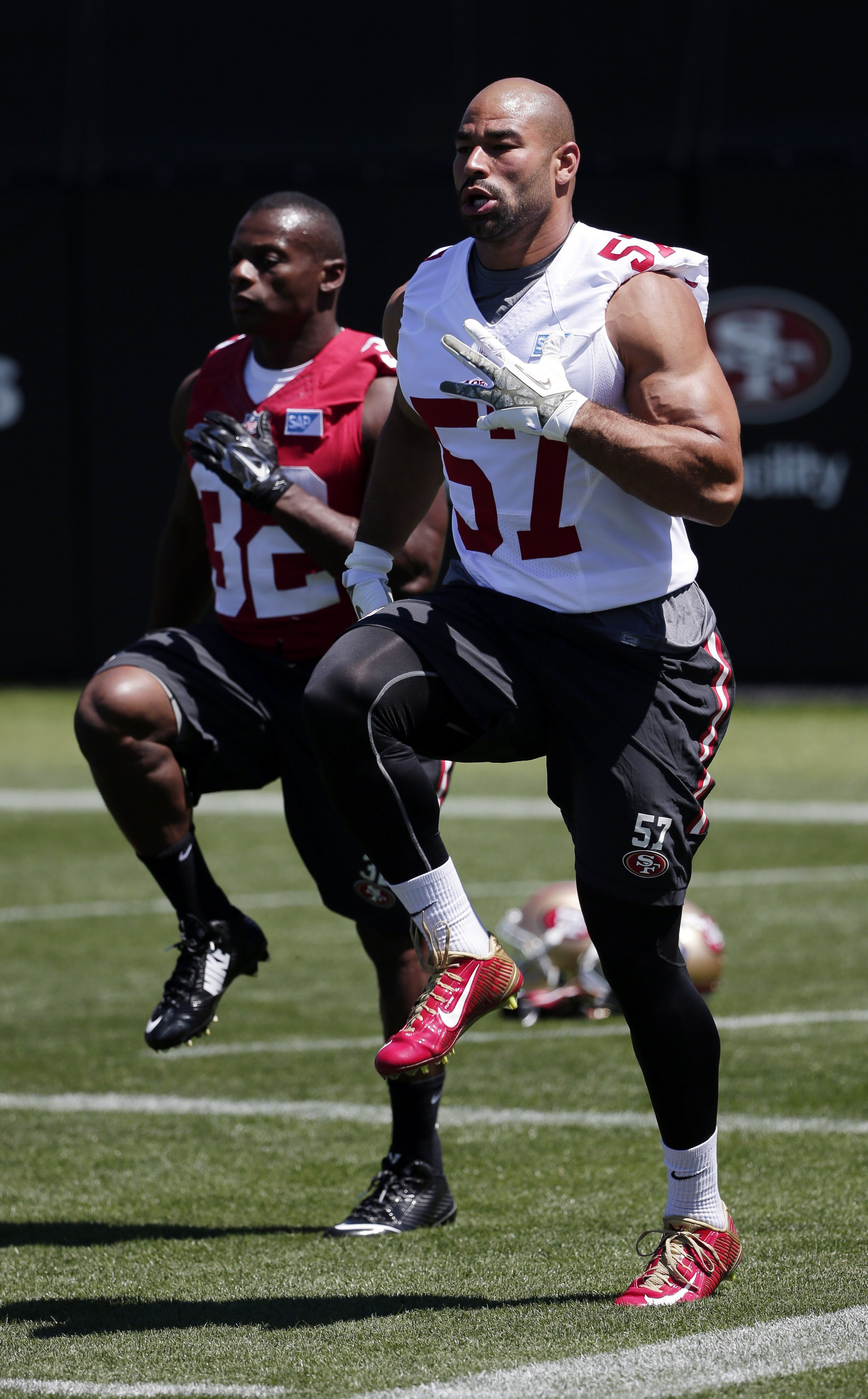 AP PhotoSan Francisco 49ers linebacker Michael Wihoite (57) warms up next to teammate Kendall Hunter (32) during an NFL football training camp on Friday