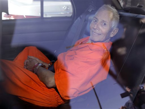 This Tuesday, March 17, 2015, file photo shows Robert Durst is transported from Orleans Parish Criminal District Court to the Orleans Parish Prison after his arraignment on murder charges in New Orleans.  (AP Photo/Gerald Herbert, File)