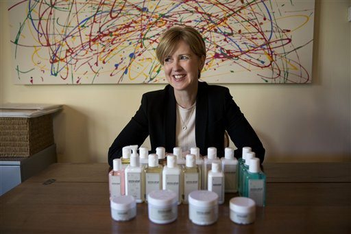 Matt Dunham/AP PhotoAromatherapist Emma Arkell poses for a portrait with one of the natural remedies for the skin and body she makes near Winchester
