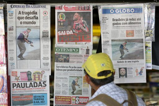 Brazilian newspaper covers show the photo of the dead 3-year-old Syrian boy on a Turkish beach, at a news stand in Brasilia, Brazil, Thursday. (AP Photo/Eraldo Peres)