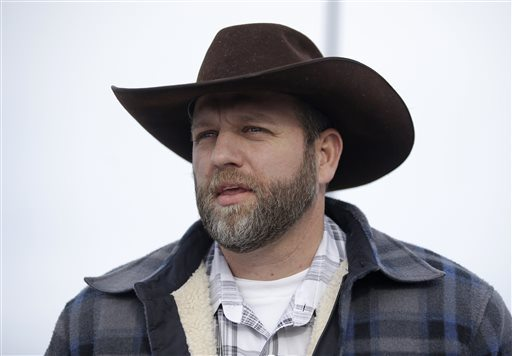 Ammon Bundy, one of the sons of Nevada rancher Cliven Bundy, speaks with reporters during a news conference at Malheur National Wildlife Refuge headquarters Monday near Burns, Ore. (AP Photo/Rick Bowmer)