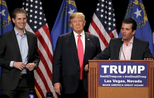 Donald Trump Jr., right, with his father, Republican presidential candidate Donald Trump, center, and his brother, Eric Trump, left, during a campaign rally on Thursday in Las Vegas. (AP Photo/Isaac Brekken)