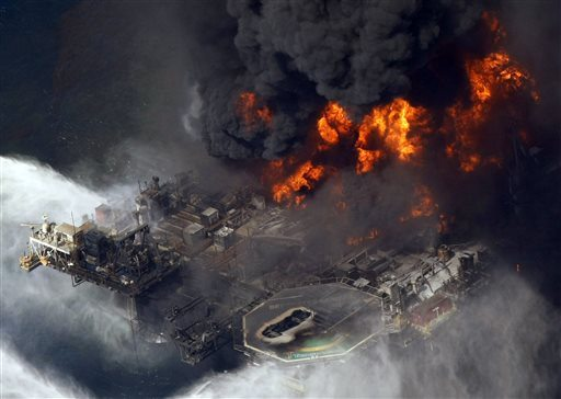 In this April 21, 2010, file photo, the Deepwater Horizon oil rig burns in the Gulf of Mexico, more than 50 miles southeast of Venice, La. (AP Photo/Gerald Herbert, File)