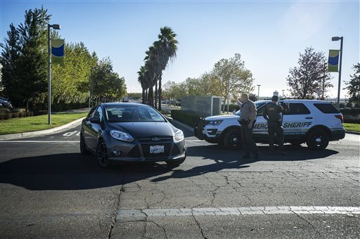 Merced County Sheriff deputies direct traffic out of the UC Merced, as the campus is placed on lockdown after a stabbing in Merced on Wednesday.  (Andrew Kuhn/Merced Sun-Star via AP)