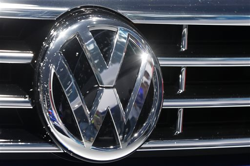 In this Sept. 22, 2015, file photo, the Volkswagen logo of a car is photographed during a car show in Frankfurt, Germany. (Michael Probst/AP)