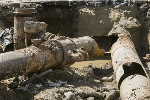 """AP Photo/Damian DovarganesLos Angeles Department of Water and Power """"Y"""" shaped juncture where a water rupture occurred"""