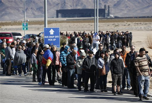 Patrons line up to buy Powerball lottery tickets outside the Primm Valley Casino Resorts Lotto Store just inside the California border Tuesday near Primm, Nev.  (AP Photo/John Locher)
