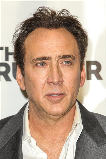Nicolas Cage, who unwittingly bought a stolen dinosaur skull from a Beverly Hills gallery, has agreed to return it to Mongolia. (Paul A. Hebert/ Invision/AP)