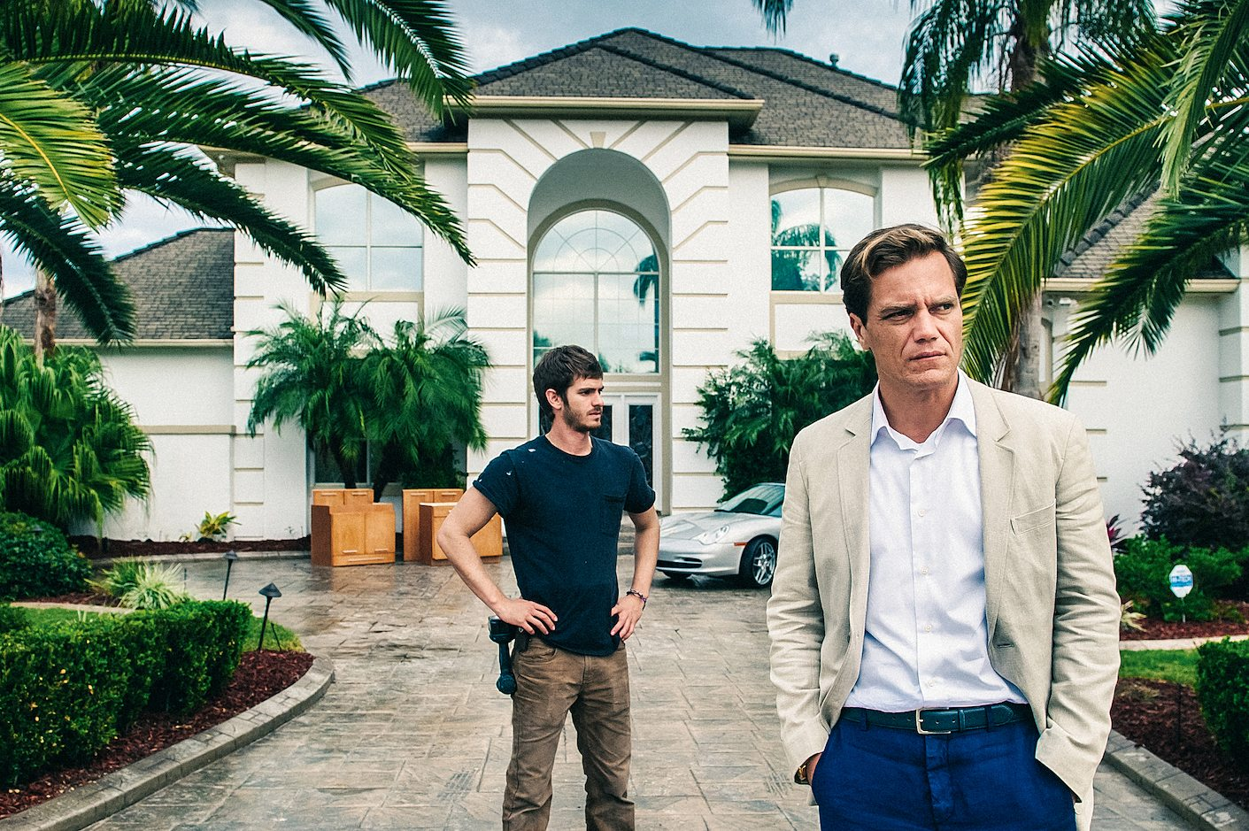 "Andrew Garfield, left, and Michael Shannon appear in ""99 Homes."""