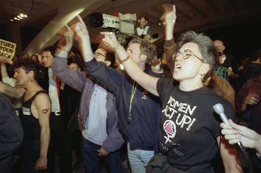 ACT UP protesters shout on the floor of the Moscone Center on June 25, 1990 to disrupt the keynote speech of then-U.S. Secretary of Health and Human Services Louis Sullivan at the 6th International AIDS Conference. AP Photo/Bill Beattie