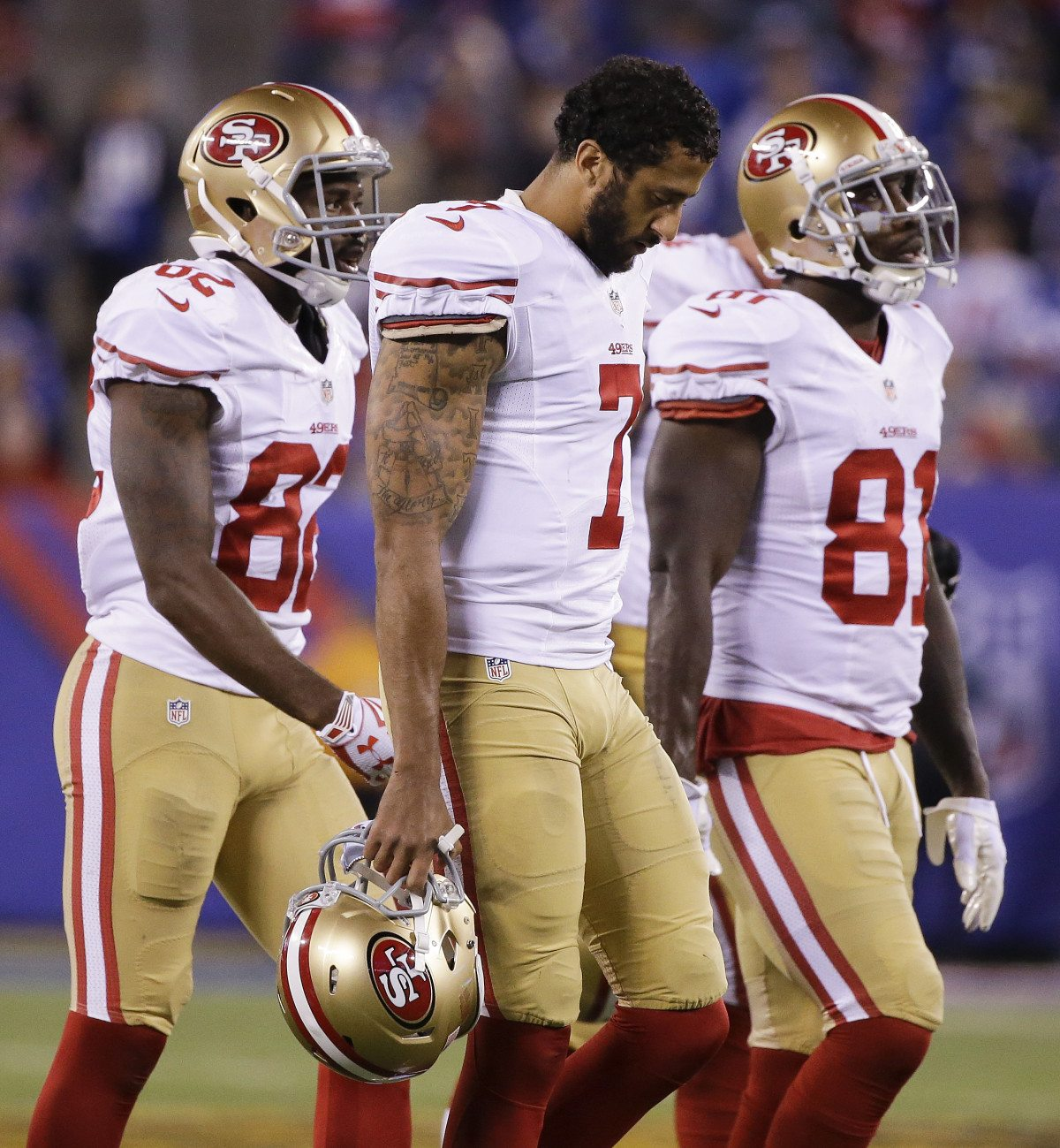 San Francisco 49ers quarterback Colin Kaepernick (7) walks off the field with wide receiver Torrey Smith (82) and wide receiver Anquan Boldin (81) during the fourth quarter game against the New York Giants, Sunday, Oct. 11, 2015, in East Rutherford, N.J. (Seth Wenig/AP)