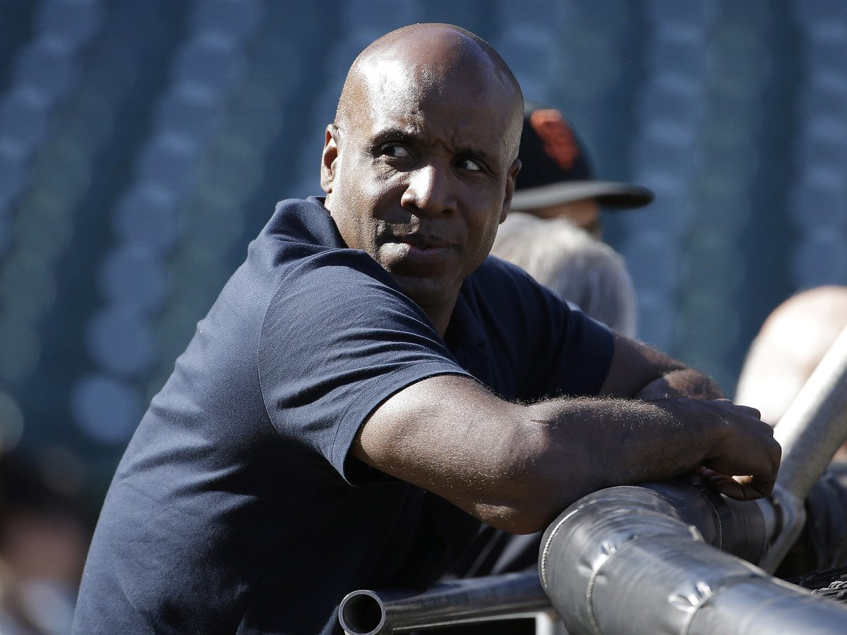 Barry Bonds watches the Giants take batting practice before a game against the Philadelphia Phillies on July 11 in San Francisco. (Jeff Chiu/AP)