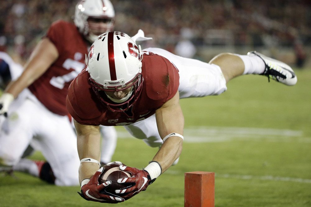 Stanford's Christian McCaffrey lunges into the end zone for a touchdown against Arizona on Oct. 3, 2015. McCaffrey was selected as The Associated Press college football player of the year on Tuesday, becoming the first non-Heisman Trophy winner to earn the honor in six years. (Marcio Jose Sanchez/AP)