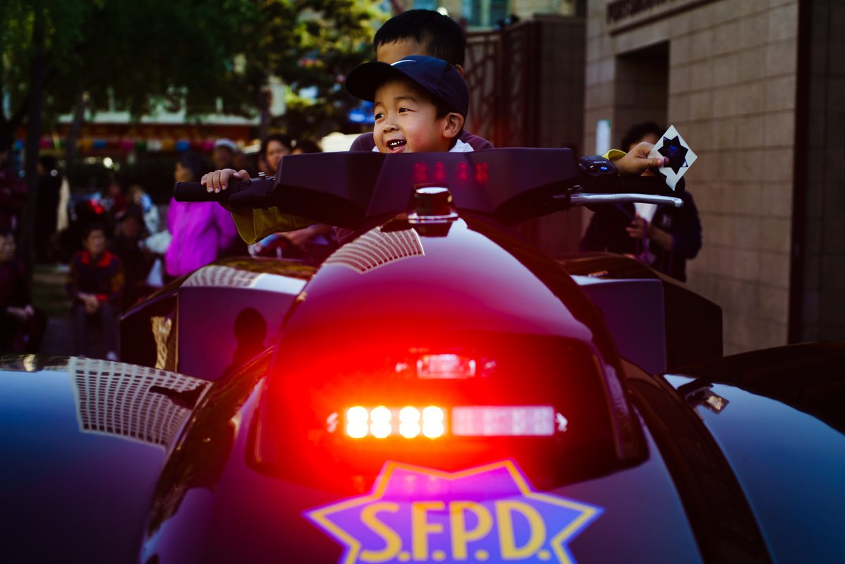 Chinatown residents hop on a San Francisco Police Department quad for a photo opportunity at the third annual Chinatown Night Out event Tuesday, September 7, 2016. (Dan Chambers/Special to S.F. Examiner)