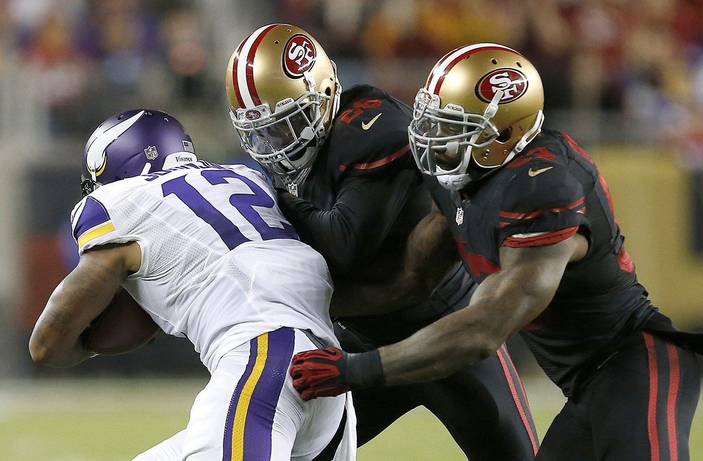 49ers linebacker NaVorro Bowman, right, and cornerback Tramaine Brock tackle Minnesota Vikings wide receiver Charles Johnson (12) during the second half of game on Monday. (AP Photo/Tony Avelar)