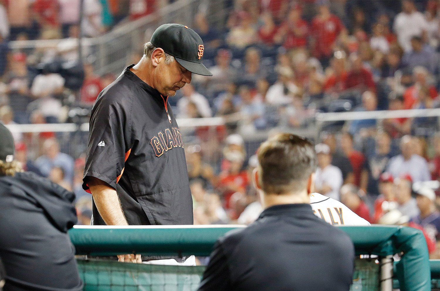 Bruce Bochy (15) heads into the dugout after being ejected during the fifth inning against the Washington Nationals on Sunday. (Alex Brandon/AP)