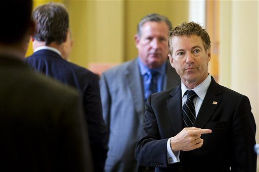 Republican presidential candidate, Sen. Rand Paul, R-Ky. points while talking with visitors on Capitol Hill in Washington, Wednesday, Sept. 30, 2015. (Jacquelyn Martin/AP)