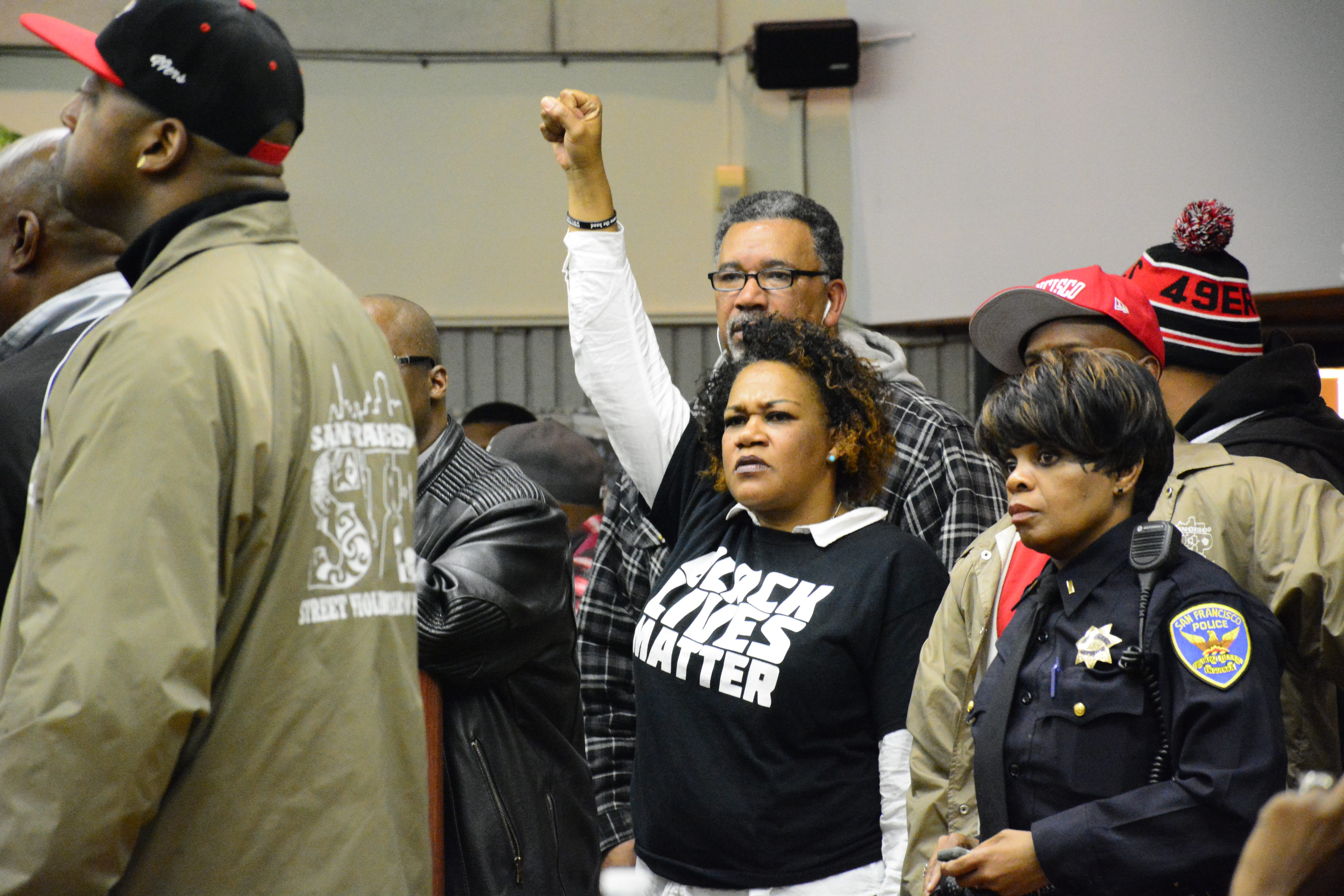 community memebers reacted to a public forum held by SFPD on friday night to discuss the most recent officer involved shooting of Mario Woods who was gunned down by officers on December 2. (Connor Hunt/Special to SF Exmainer)