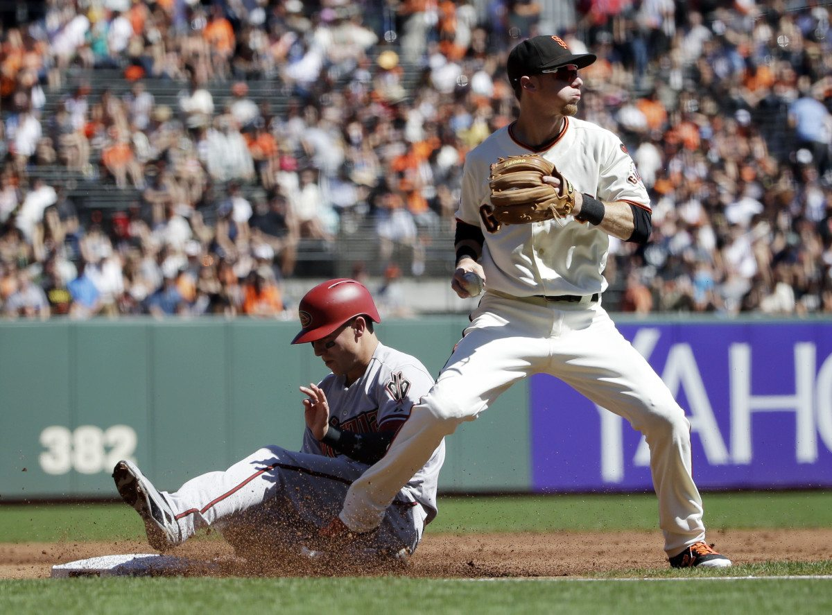 Arizona Diamondbacks' Jake Lamb, left, is forced out at third base by San Francisco Giants' Matt Duffy after a bunt from Patrick Corbin during the second inning of a baseball game on Saturday, Sept. 19, 2015, in San Francisco. (Marcio Jose Sanchez/AP)