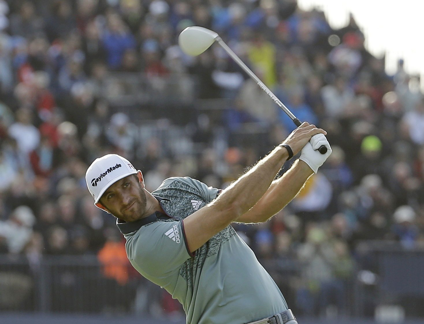 Dustin Johnson drives a ball  from the 18th tee during the second round of the British Open at the Old Course, St. Andrews, Scotland on Saturday. (AP Photo/David J. Phillip)