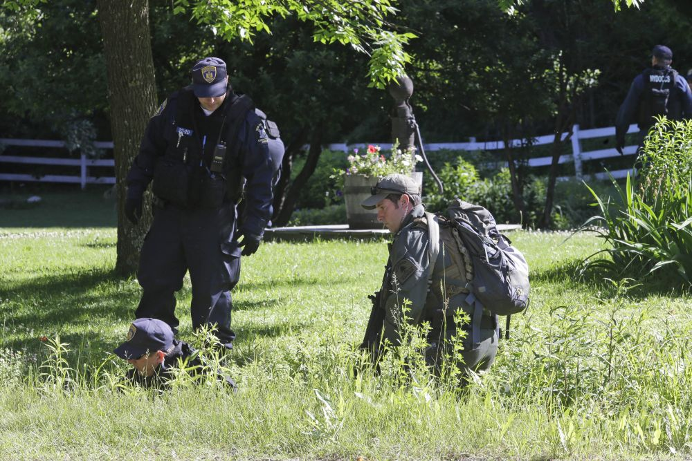 New York State Department of Corrections Officers and a forest ranger, right, patrol an area in Owls Head, N.Y. for convicted murderers Richard Matt and David Sweat, Friday, June 26, 2015. Police shifted a focus of their three week search closer to the Canadian border. (Mary Altaffer/AP Photo)