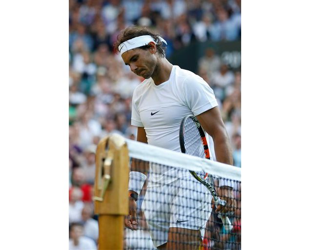 Rafael Nadal of Spain walks after losing the singles match against Dustin Brown of Germany, at the All England Lawn Tennis Championships in Wimbledon. (Pavel Golovkin/AP Photo)