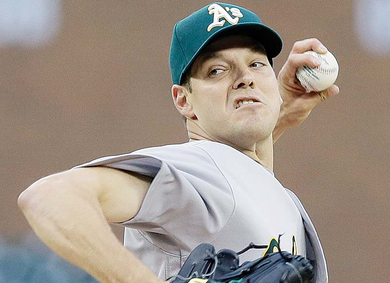 Oakland Athletics starting pitcher Rich Hill throws against the Detroit Tigers on Tuesday. (AP Photo/Carlos Osorio)