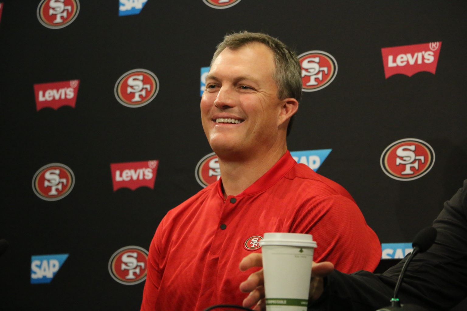 San Francisco 49ers general manager John Lynch addresses the media at Levi's Stadium on July 25, 2018. (Ryan Gorcey / S.F. Examiner)