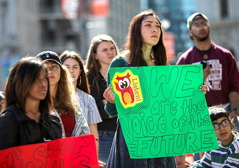 Lowell High School students hold signs during a walkout protest of racism at their school, in front of San Francisco City Hall on Tuesday, February 23, 2016. (Ekevara Kitpowsong/ Special to S.F. Examiner)