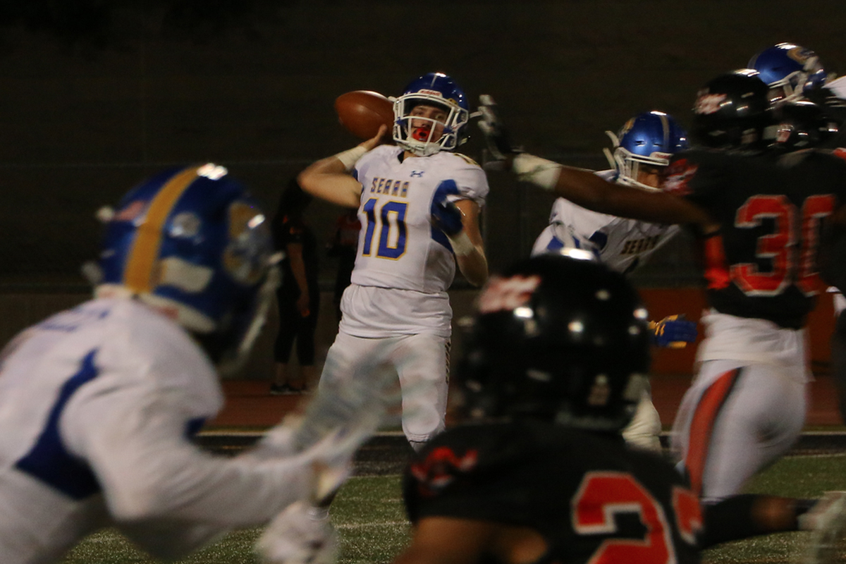San Mateo-Serra quarterback Luke Bottari attempts a pass during the third quarter of a game at Pittsburg on Sept. 7, 2018. (Ryan Gorcey / S.F. Examiner)