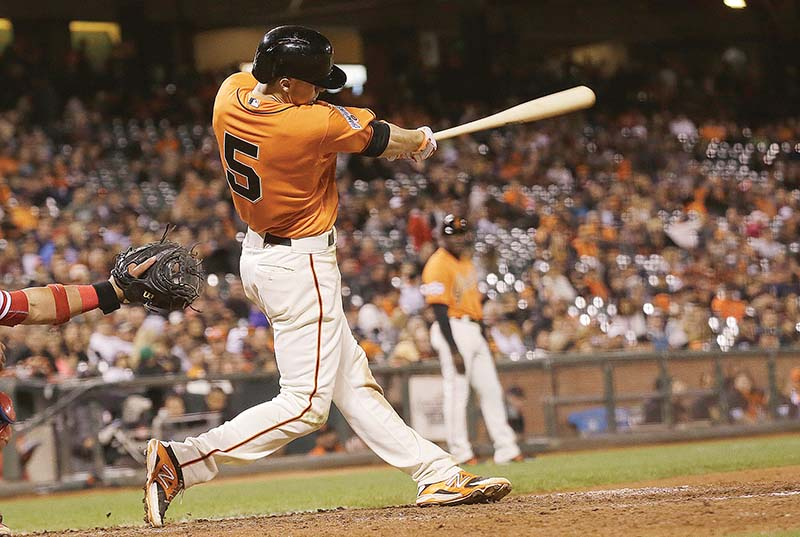 The Giants' Matt Duffy is no longer overshadowed by Skeeter, his 35-pound pet cat that has to be locked out of the kitchen for obvious reasons. (AP Photo/Jeff Chiu)