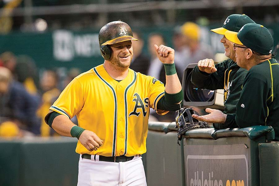 Stephen Vogt celebrates after hitting a home run in the bottom of the fourth inning of the Oakland A's victory over the Baltimore Orioles on Monday.(Stan Olszewski/Special to S.F. Examiner)