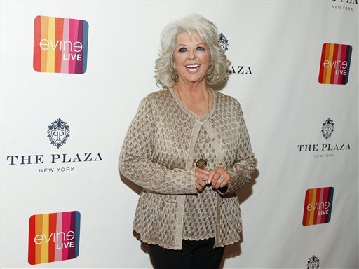 "Paula Deen is seen at an event at the Todd English Food Hall in New York. A spokesman for Deen says she didn't post a 2011 Halloween costume photo on her Twitter account showing her son Bobby in dark makeup as ""I Love Lucy"" character Ricky Ricardo. (Andy Kropa/Invision/AP)"