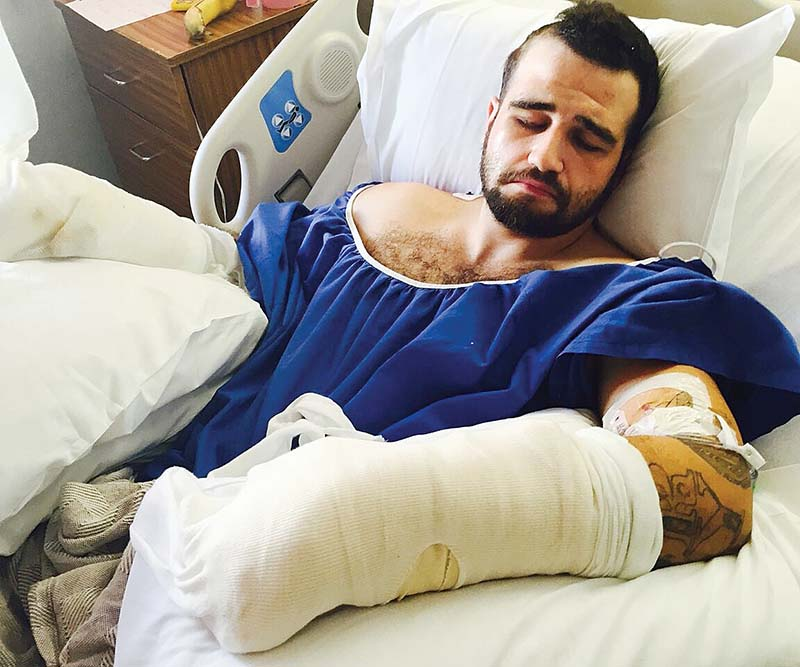 Stanislav Petrov, seen in a hospital bed after the beating by two Alameda County sheriff's deputies, filed a federal civil