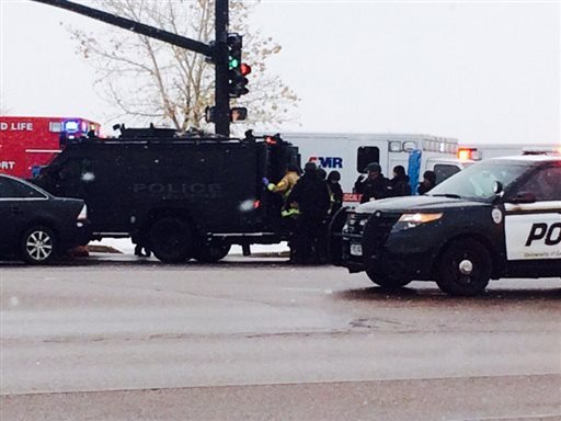 Authorities respond after reports of a shooting near a Planned Parenthood clinic Friday, Nov. 27, 2015, in Colorado Springs, Colo. (Kody Fisher/FOX21 News via AP)