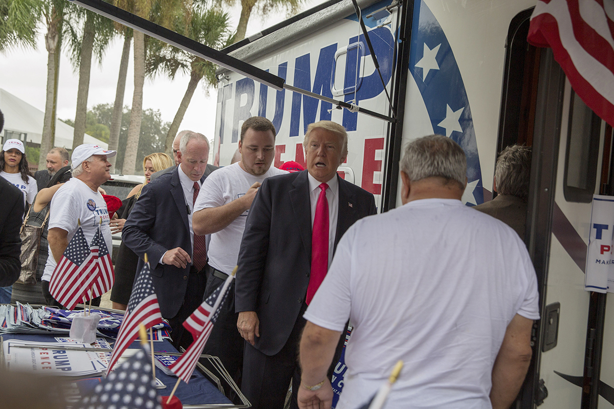 Republican presidential nominee Donald Trump meets supporters organizing voter registration and support for his campaign just before a rally at the Florida State Fairgrounds in Tampa, Fla., on Aug. 24, 2016.  (Loren Elliott/Tampa Bay Times/TNS)