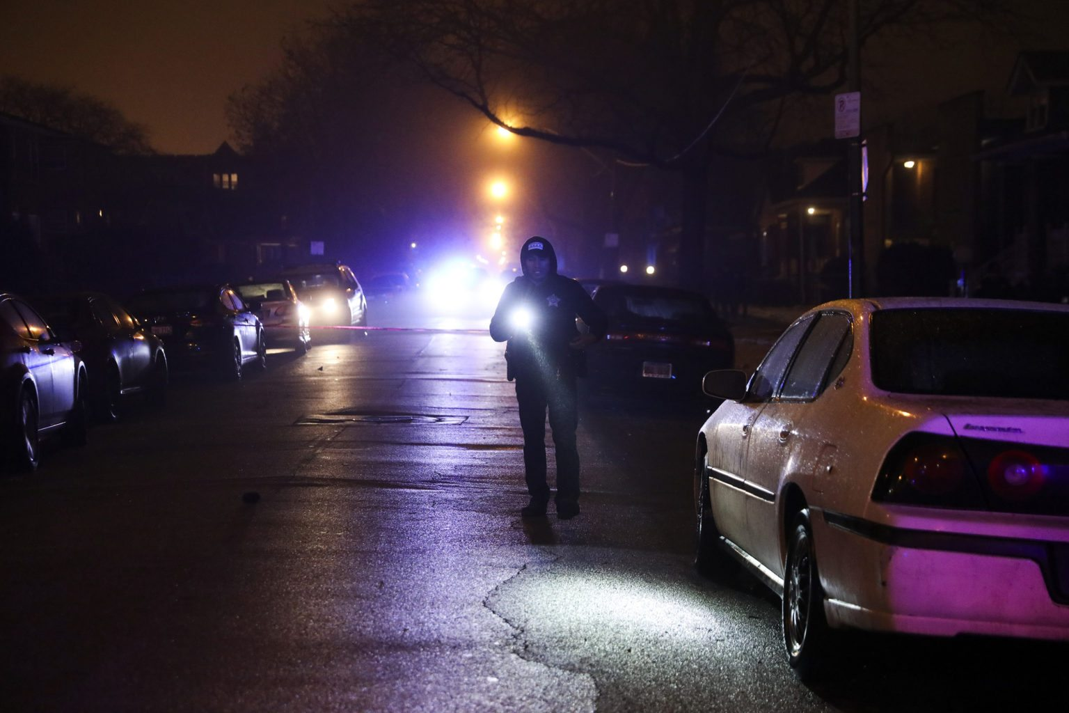 A member of the Chicago Police Department works the scene where at least six people were shot, one fatally, on the 8600 block of South Maryland Avenue Sunday, Dec. 25, 2016 in Chicago. (Armando L. Sanchez/Chicago Tribune/TNS)