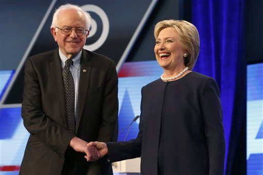 Democratic presidential candidates, Hillary Clinton and Sen. Bernie Sanders, I-Vt,  shake hands before the start of the Univision, Washington Post Democratic presidential debate at Miami-Dade College on Wednesday in Miami, Fla. (AP Photo/Wilfredo Lee)