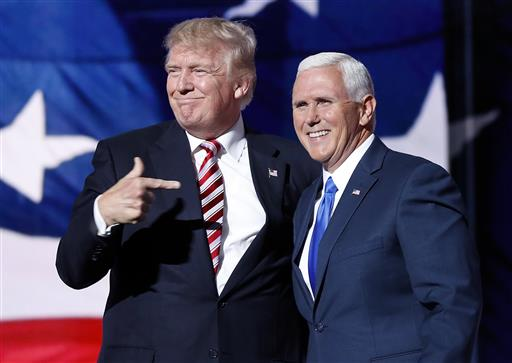 Republican presidential candidate Donald Trump, points toward Republican vice presidential candidate Indiana Gov. Mike Pence after Pence's acceptance speech during the third day session of the Republican National Convention in Cleveland on Wednesday. (AP Photo/Mary Altaffer)