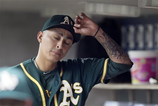 Carlos Osorio/APA's starting pitcher Jesse Chavez takes his hat off after being relieved in the sixth inning of Wednesday's loss in Detroit.