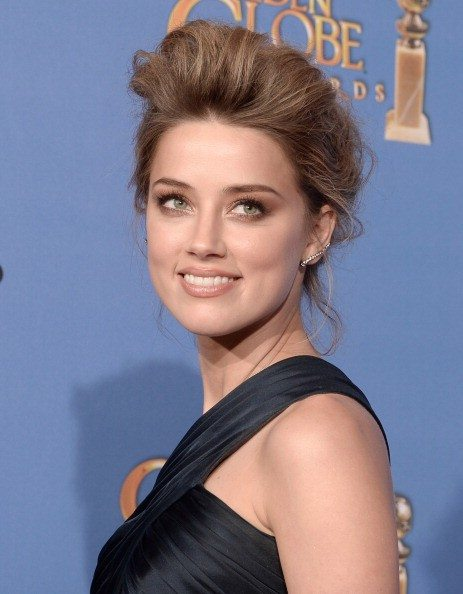 Kevin Winter/Getty ImagesActress Amber Heard poses in the press room during the 71st Annual Golden Globe Awards held at The Beverly Hilton Hotel on January 12