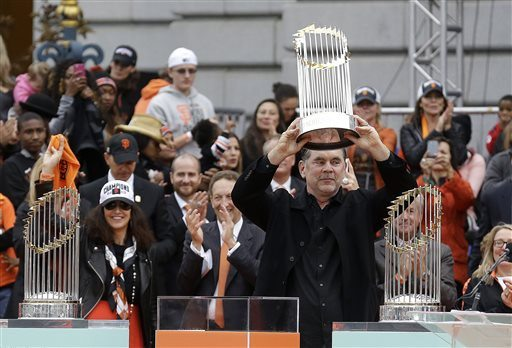 AP file photo/Jeff ChiuSan Francisco Giants manager Bruce Bochy holds up the 2014 World Series baseball trophy as the team's 2010 and 2012 trophies are displayed during the 2014 World Series victory celebration in Civic Center Plaza in San Francisco on Oct. 31. All three trophies will be available to see on various dates in January and February in California