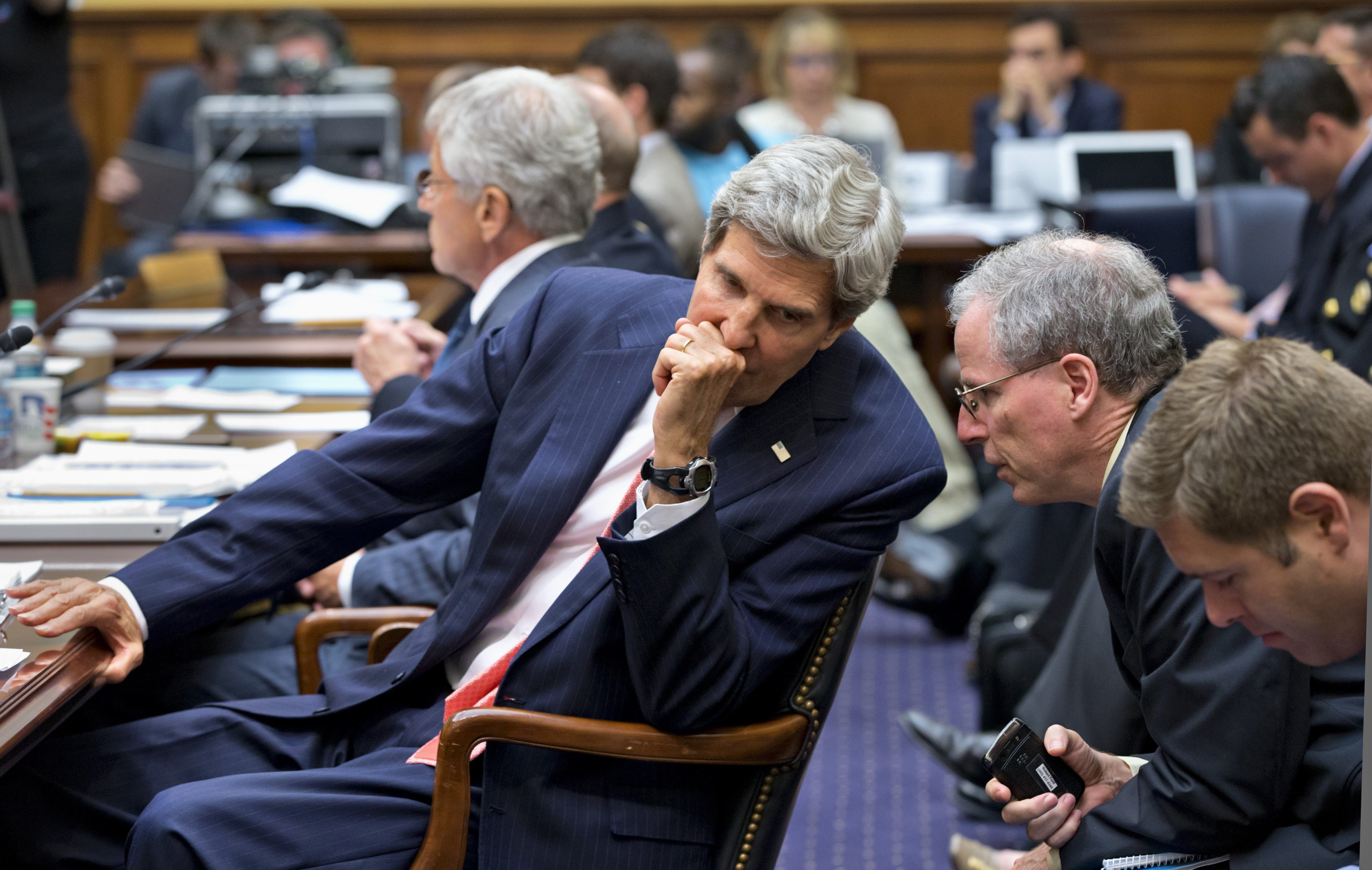 AP Photo/J. Scott ApplewhiteSecretary of State John Kerry confers with U.S. Ambassador to Syria Robert Ford