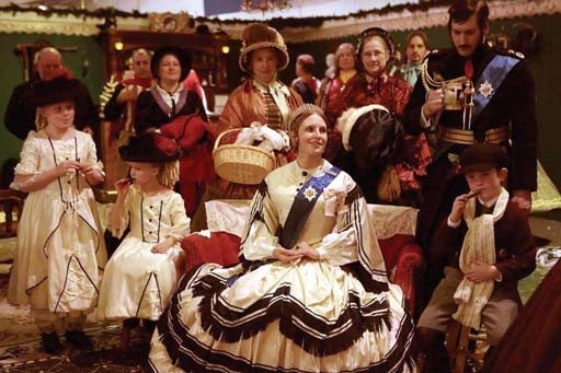 Courtesy photoFamous people: Queen Victoria herself is among the dozens of characters populating the Great Dickens Christmas Fair at the Cow Palace.