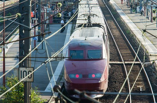 A Thalys train of French national railway operator, SNCF, stands at the main train station in Arras, northern France, after a gunman opened fire injuring three people, Friday, Aug. 21, 2015. (AP Photo)