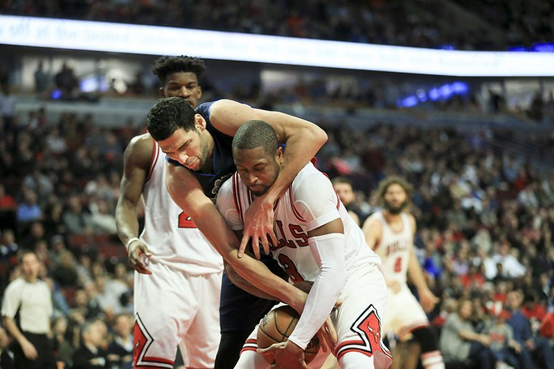 Dallas Mavericks center Salah Mejri (50) and Chicago Bulls guard Dwyane Wade (3) fight for possession of a rebound during the second half at the United Center Tuesday, Jan. 17, 2017 in Chicago. The Mavericks won 99-98. (Armando L. Sanchez/Chicago Tribune/TNS)
