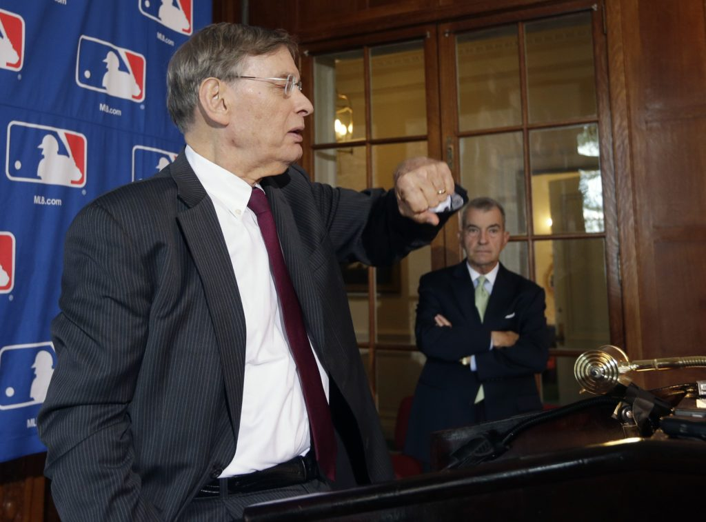 AP Photo/Mike GrollMajor League Baseball Commissioner Bud Selig checks his watch before a news conference following baseball meetings at the Otesaga Hotel on Thursday