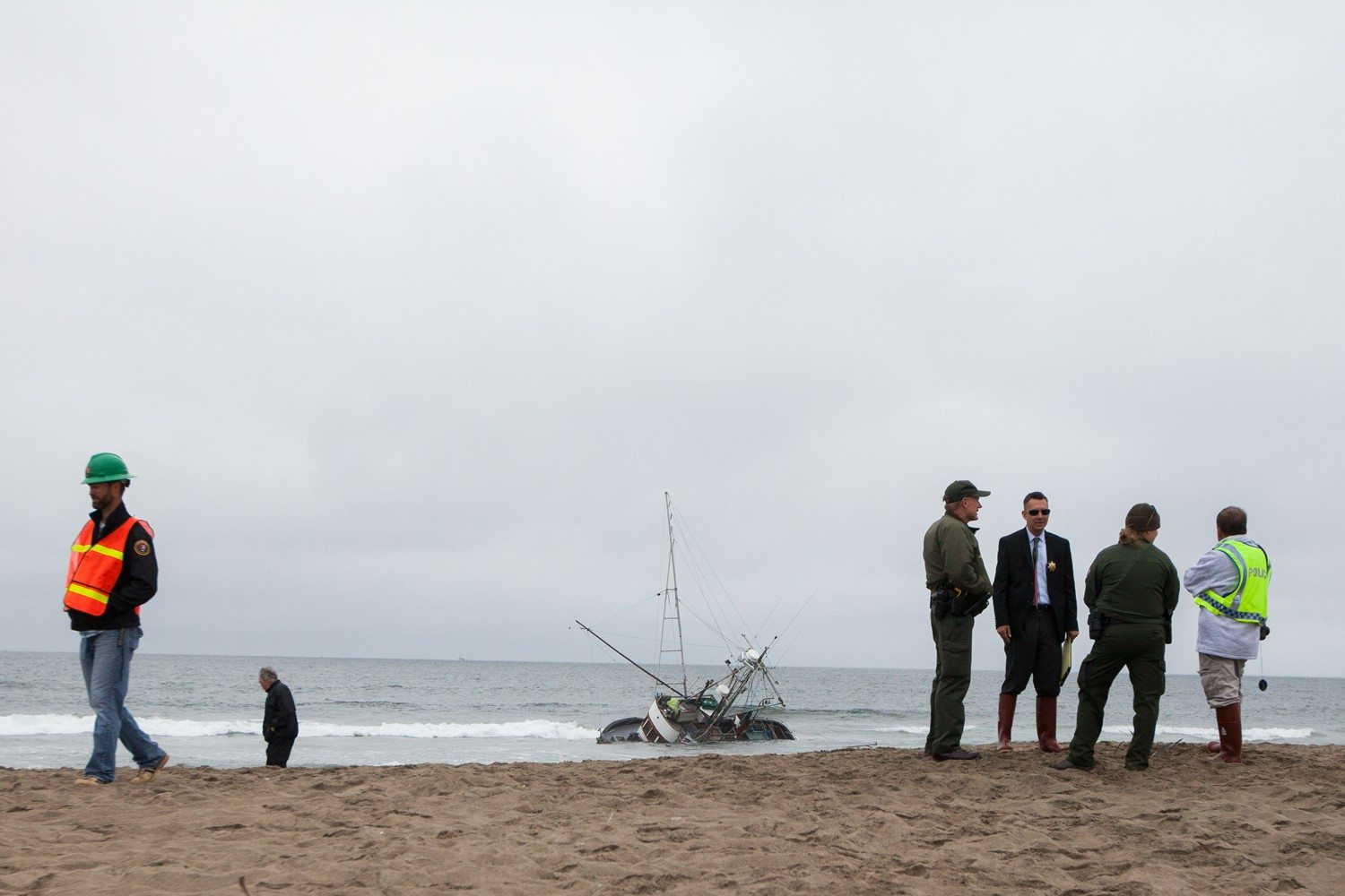 Nathaniel Y. Downes/special to the s.f. examinerCrews are working to remove a fishing boat from Ocean Beach.
